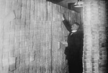 GERMANY - CIRCA 1900: Inflation in Weimar Germany has paper money stacked from Floor to Ceiling in a Berlin Bank; banker is counting sheaves of bundled notes. (Photo by Buyenlarge/Getty Images)