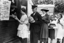 1923, Germany --- People exchange bread, sausage, jam and other goods for circus tickets. A food emergency in Germany after the First World War and the catastrophic collapse of German currency led to the fact that material assets were used in place of money. --- Image by © Keystone/Corbis